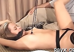 Ballgagged wench gets aroused by means of the time that playing with herself