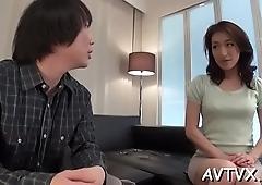 Asian babe sucks a dildo whilst enjoying doggystyle sex
