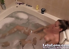 Masturbating with my vibrator in the bathtub
