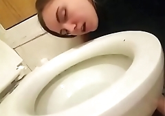 Nasty slut Haley Hess licks a toilet